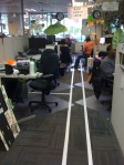 Tape lines on the floor in an office